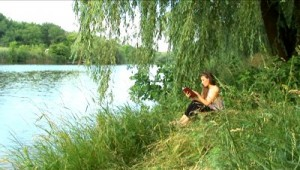 stock-footage-girl-reads-the-book-on-the-bank-of-river (1)